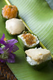 Thai traditional dessert. Thai dessert, sweet sticky rice with different kinds of topping Stock Photo