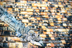 Thai traditional dragon decorated on roof of buddhist temple Stock Images