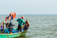 Thai traditional fisherman pull up the fishnet royalty free stock photos