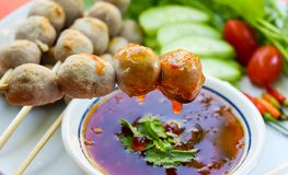 Thai traditional food,grilled pork meatballs and sweet chili sauce. Traditional Thai food,Grilled pork meatballs and fresh vegetables with sweet chili sauce on Stock Photos