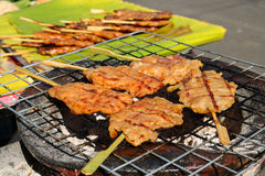 Thai Traditional Food, grilled pork with sweet and salty sauce. Pork BBQ on charcoal stove Royalty Free Stock Photos