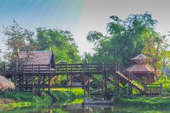 Thai traditional houses style along canal, Mueang Mallika hist. Oric site in Kanchanaburi, Thailand royalty free stock images