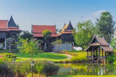 Thai traditional houses style along canal, Mueang Mallika hist. Oric site in Kanchanaburi, Thailand royalty free stock photo