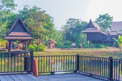 Thai traditional houses style along canal, Mueang Mallika hist. Oric site in Kanchanaburi, Thailand stock image
