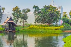 Thai traditional houses style along canal, Mueang Mallika hist. Oric site in Kanchanaburi, Thailand stock photos