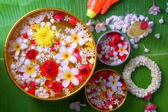 Thai traditional jasmine garland and Colorful flower in water bo. Wls decorating and scented water, perfume, marly limestone, pipe gun on Banana leaf for Royalty Free Stock Photography