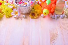 Thai traditional jasmine garland and Colorful flower in water bowls decorating and scented water, perfume, marly limestone. Pipe gun on wood background for Stock Image