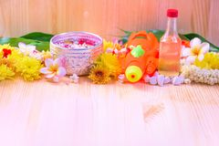 Thai traditional jasmine garland and Colorful flower in water bowls decorating and scented water, perfume, marly limestone. Pipe gun on wood background for Royalty Free Stock Photo