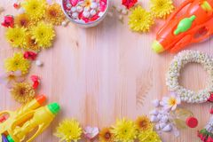 Thai traditional jasmine garland and Colorful flower in water bowls decorating and scented water, perfume, marly limestone. Pipe gun on wood background for Stock Images