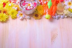 Thai traditional jasmine garland and Colorful flower in water bowls decorating and scented water, perfume, marly limestone. Pipe gun on wood background for stock photos