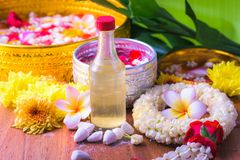 Thai traditional jasmine garland and Colorful flower in water bowls decorating and scented water, perfume, marly limestone. For Songkran Festival or Thai New Stock Photo