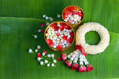 Thai traditional jasmine garland. Symbol of Mother`s day in thailand on Banana leaf Royalty Free Stock Photo
