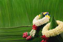 Thai traditional jasmine garland. Symbol of Mother`s day in thailand on Banana leaf Stock Images