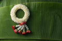 Thai traditional jasmine garland. Symbol of Mother`s day in thailand on Banana leaf Royalty Free Stock Photos