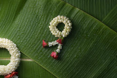 Thai traditional jasmine garland. Symbol of Mother`s day in thailand on Banana leaf Stock Photo
