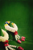 Thai traditional jasmine garland. Symbol of Mother`s day in thailand on Banana leaf Royalty Free Stock Image