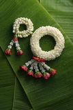 Thai traditional jasmine garland. Symbol of Mother`s day in thailand on Banana leaf Stock Image