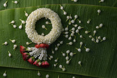Thai traditional jasmine garland. Symbol of Mother`s day in thailand on Banana leaf Royalty Free Stock Photography