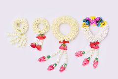Thai traditional jasmine garland. Symbol of Mother`s day in thailand on white background Royalty Free Stock Photography