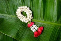Thai traditional jasmine garland. On Banana leaf Stock Photos