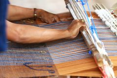 Thai traditional lady weaving knitting work, women activity picture, upcountry lifestyle at village east of Thailand Stock Images