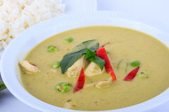 Thai traditional and popular food, Thai chicken green curry intense soup on white background. Royalty Free Stock Photography