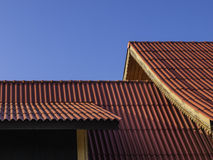 Thai traditional roof tile against with blue sky Stock Photos