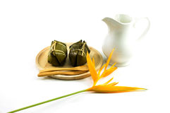 Thai traditional sticky rice dessert in banana leaf packaging. Royalty Free Stock Images