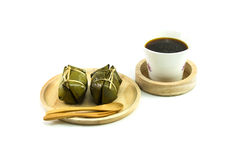 Thai traditional sticky rice dessert in banana leaf packaging. Stock Photography