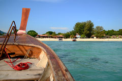Thai traditional wooden boat head to the beach on island. Thai traditional wooden boat head to the beach on Lipe island, Southern of Thailand stock photos