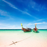 Thai traditional wooden boat at ocean shore Thailand Stock Photos