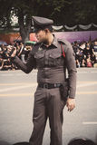 Thai traffic police officer on duty outside the Grand Palace road Bangkok,Thailand. Royalty Free Stock Photography