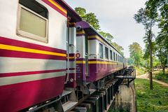Thai train on the historical bridge over the river Kwai Royalty Free Stock Photo