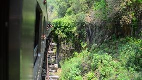 Thai Train on River Kwai history Bridge of Kanchanaburi stock video footage