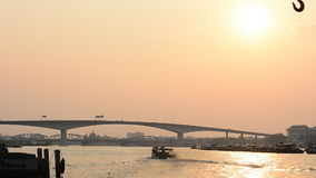Thai transportation, boat on the Chaophaya river under the beautiful at sunset in Bangkok, THAILAND stock video footage