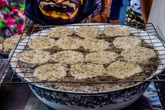 Thai treader grilling Rice Crackers stock image