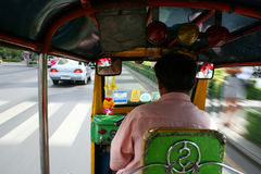Thai tuk tuk taxi on the road, Bangkok. Stock Photography