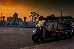 Thai Tuktuk or tricycle at Ananta Throne, Bangkok. Thai Tuktuk or tricycle parking to wait for visitors or foreign tourists at Ananta Samakhom Throne Hall at royalty free stock images