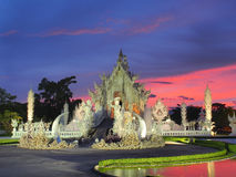 Thai Unique Temple (The White Temple) under amazed sky Stock Photo