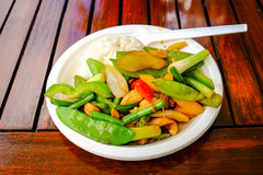 Thai vegetables. Thai food served on a paper plate outdoors Stock Image