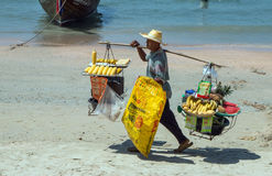 Thai vendor on beach. A Thai street vendor carrying fruit,snacks and other commodities to sell on Railay Beach,Krabi Province,Thailand.Photo taken March,5th,2016 Stock Photos