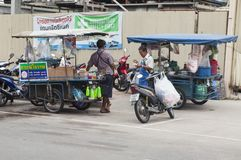 A Thai vendor selling street food Royalty Free Stock Photo