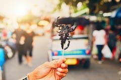 Thai vendor showing roasted scorpio Royalty Free Stock Photos