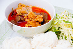 Thai vermicelli eaten with chicken curry  on white backg Stock Photo