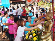 Thai villagers bathe the Buddha, Songkran festival, Thailand Royalty Free Stock Photo