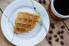 Thai waffle on white dish and coffee, Top view. Stock Image