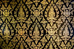 Thai wall paper. Handmade Thai style Church wall gold color with black background royalty free stock image
