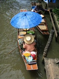 Thai water market. Woman selling foods on a floating market in Thailand - Damnoen Saduak Floating Market, neer bangkok royalty free stock images