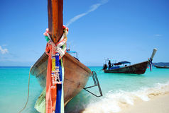 Thai water taxi. Thai traditional fishing wooden boat aka longtail boat, bamboo island Stock Photography