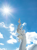 Thai White Dragon statue. At the Temple on blue sky background Royalty Free Stock Photos